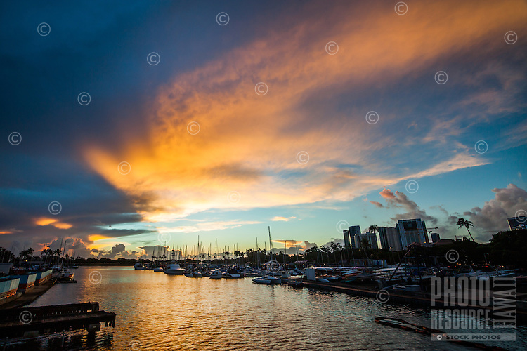 Sunset at Ala Wai Harbor, looking towards the yacht club, Honolulu, O'ahu.