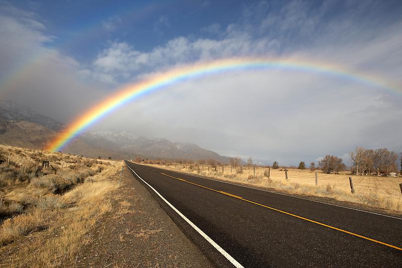 Rainbow on highway near Cedarville. Nevada