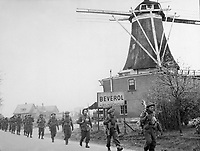 Infantry of the Regiment de Maisonneuve moving through Holten to Rijssen, both towns in the Netherlands.  9 April 1945.  Lt. D. Guravitch.  Canadian Military photograph.  New York Times Paris Bureau Collection.  (USIA)<br /> NARA FILE #:  306-NT-1334B-11<br /> WAR & CONFLICT BOOK #:  1081