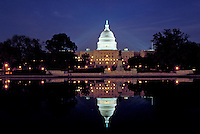 The US Capitol building is reflected in the reflecting pool on the Mall, Washington, DC. Washington DC USA.