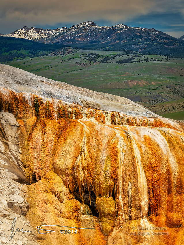 Travertine Ridge, Mammoth Hot Springs ©2018 James D Peterson.  This rugged shoulder of colorful mineral deposits in Yellowstone National Park stands out against a backdrop of snowy peaks in the Absaroka-Beartooth Wilderness of southern Montana.
