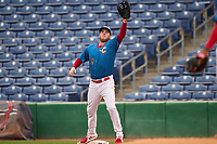 Clearwater Threshers first baseman Rixon Wingrove (52) stretches for a throw during a game against the Fort Myers Mighty Mussels on July 29, 2021 at BayCare Ballpark in Clearwater, Florida.  (Mike Janes/Four Seam Images)