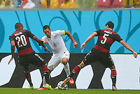 Clint Dempsey of USA tries to get between Jerome Boateng and Mats Hummels of Germany