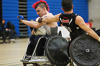 27 MAY 2013 - DONCASTER, GBR - David Anthony (left) of the South Wales Pirates battles to keep the ball from Alan Ash of the West Coast Crash during their 2013 Great Britain Wheelchair Rugby Nationals bronze medal match at The Dome in Doncaster, South Yorkshire, Great Britain (PHOTO (C) 2013 NIGEL FARROW)