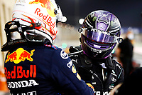 28th March 2021; Sakhir, Bahrain; F1 Grand Prix of Bahrain, Race Day;   F1 Grand Prix of Bahrain 33 Max Verstappen NED, Red Bull Racing congratulates winner 44 Lewis Hamilton GBR, Mercedes-AMG Petronas F1 Team, F1 Grand Prix of Bahrain