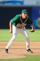 Third baseman Chase Austin #8 of the Greensboro Grasshoppers on defense against the Hickory Crawdads at  L.P. Frans Stadium July 10, 2010, in Hickory, North Carolina.  Photo by Brian Westerholt / Four Seam Images