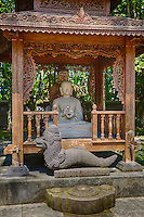Borobudur, Java, Indonesia.  Mendut Buddhist Monastery.  Two Interpretations of Buddha: Chinese Style in Back, Javanese Style in Front.