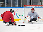 Sochi, RUSSIA - Mar 2 2014 -  Billy Bridges takes a shot on Benoit St-Amand during  practice before the 2014 Paralympics in Sochi, Russia.  (Photo: Matthew Murnaghan/Canadian Paralympic Committee)