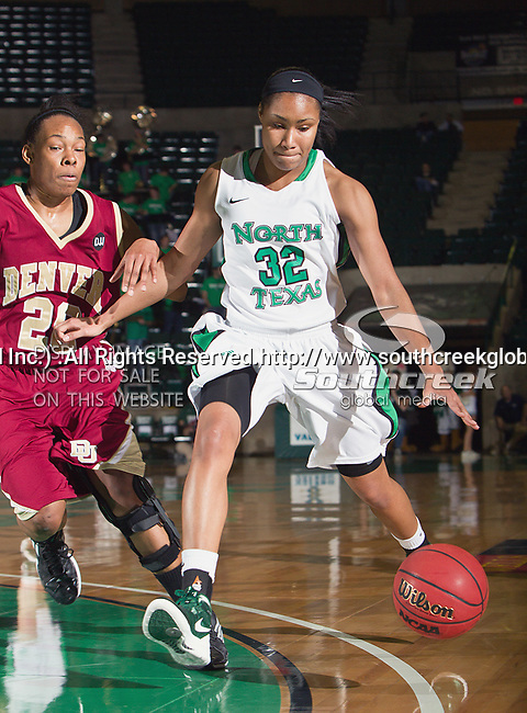 North Texas Mean Green guard Desiree Nelson (32) in action during the game between the Denver Pioneer Women and the University of North Texas Mean Green at the North Texas Coliseum,the Super Pit, in Denton, Texas. Denver defeats UNT 50 to 44...
