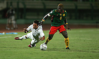 The United States' Danny Cruz is tugged along by Cameroon's Charley Fomen during the FIFA Under 20 World Cup Group C Match between the United States and Cameroon at the Mubarak Stadium on September 29, 2009 in Suez, Egypt.