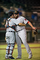 Mesa Solar Sox catcher Jake Rogers (8) and relief pitcher Mike Shawaryn (55), of the Boston Red Sox organization, celebrate a victory after an Arizona Fall League game against the Scottsdale Scorpions on October 9, 2018 at Scottsdale Stadium in Scottsdale, Arizona. The Solar Sox defeated the Scorpions 4-3. (Zachary Lucy/Four Seam Images)
