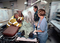 Ambulance crews rush the victim of a heart attack into the crash room of an accident and emergency department. This image may only be used to portray the subject in a positive manner..©shoutpictures.com..john@shoutpictures.com