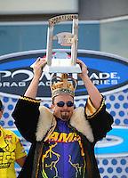 Nov. 2, 2008; Las Vegas, NV, USA: NHRA pro modified driver Joshua Hernandez celebrates with the championship trophy during the Las Vegas Nationals at The Strip in Las Vegas. Mandatory Credit: Mark J. Rebilas-