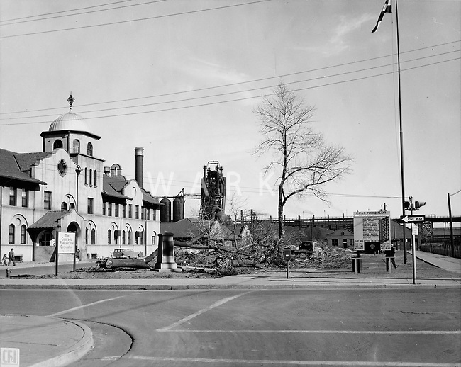 "A view of the MInnequa Works Main Office complex showing the chopping down of the trees in the promenade in front of the building.<br /> Date: 1-10-56<br /> Stamped ""Blast & Publicity Department"" <br /> Women working at tabulating machines in Administrative Annex building.<br /> Date: 1953<br /> Stamped verso ""Credit Photo CF&I Blast Pueblo, Colo.""<br /> Prints Admin Pueblo Box 8"