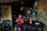"""November 08, 2014. """"Water it´s the real thing""""<br /> Raquel lives with her family in Nejapa (El Salvador). Life is so difficult for her because she does'n' t have water at home. The people of Nejapa have no drinking water because the Coca -Cola company overexploited the aquifer in the area, the most important source of water in this Central American country. This means that the population has to walk for hours to get water from wells and rivers. The problem is that these rivers and wells are contaminated by discharges that makes Coca- Cola and other factories that are installed in the area. The problem can increase: Coca Cola company has expansion plans, something that communities and NGOs want to stop. To make a liter of Coca Cola are needed 2,4 liters of water. ©Calamar2/ Pedro ARMESTRE"""