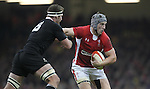 Cardiff, WALES - November 24:.Autumn International.Wales v New Zealand.Jonathan Davies keeps Kieran Read at arms length as he looks for support..24.11.12..©Steve Pope - Sportingwales