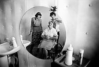 Russia. Krasnodar Krai Region. Krasnodar. Hairdresser cutting hair in the hair salon. Krasnodar (also known as Kuban) is the largest city and the administrative centre of Krasnodar Krai in Southern Russia. 27.09.1993 © 1993 Didier Ruef