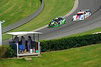 17-19  July, 2009, Birmingham, Alabama USA.#67 TRG Porsche GT3 of Andy Lally & Justin Marks & #58 Brumos Porsche/Riley of Darren Law & David Donohue..©2009 F.Peirce Williams, USA.