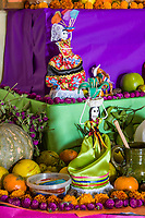 Oaxaca, Mexico, North America.  Day of the Dead Celebrations.  Doll Skeleton Altar Decoration in Memory of the Dead.  Skeleton, Skull, Flowers, Marigolds, Oranges.