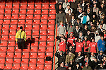 Nottingham Forest 2 Ipswich Town 0, 23/10/2010. City Ground, Championship. Nottingham Forest fans in the Brian Clough Stand shielding their eyes from the sun as they watch the action at the City Ground, Nottingham as Nottingham Forest take on visitors Ipswich Town in an Npower Championship match. Forest won the match by two goals to nil in front of 22,935 spectators. Photo by Colin McPherson.