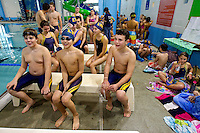 Young swimmers compete at a swim meet competition in North Carolina. Some of the individuals may have model releases in place.