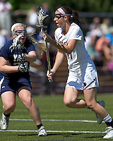 Boston College midfielder Brittany Wilton (11) on the attack as Yale University defender Kallie Parchman (24) defends. Boston College defeated Yale University, 16-5, at Newton Campus Field, April 28, 2012.