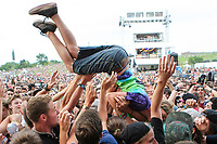 A man crowd surf during the Kiesza concert at the Festival d'ete de Quebec (Quebec City Summer Festival) Thursday July 9, 2015.