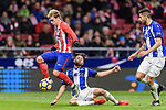 Ruben Duarte of Deportivo Alaves (R) trips up with Antoine Griezmann of Atletico de Madrid (L) during the La Liga 2017-18 match between Atletico de Madrid and Deportivo Alaves at Wanda Metropolitano Stadium on 16 December 2017 in Madrid, Spain. Photo by Diego Souto / Power Sport Images