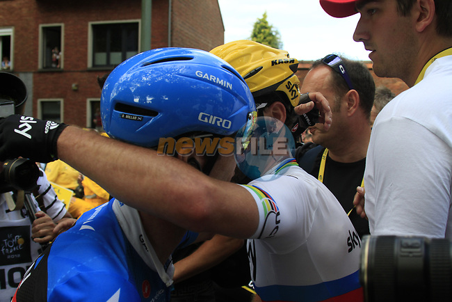 David Millar (GBR) Garmin-Sharp gives stage winner World Champion Mark Cavendish (GBR) Sky Procycling a hug at the end of Stage 2 of the 99th edition of the Tour de France 2012, running 207.5km from Vise to Tournai, Belgium. 2nd July 2012.<br /> (Photo by Eoin Clarke/NEWSFILE)