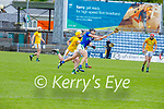 Michael Leane of Kerry gets his effort way despite the pressure from Meath's Keith Keoghan and Éamonn Ó'Donnchadha closing down on him, in the National hurling league in Austin Stack Park on Sunday