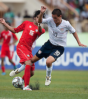 Luis Gil gets tangled up with his defender. US Under-17 Men's National Team defeated United Arab Emirates 1-0 at Gateway International  Stadium in Ijebu-Ode, Nigeria on November 1, 2009.