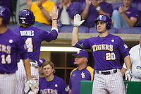 LSU Tigers designated hitter Chris Chinea #20 greets teammate Raph Rhymes #4 after he scored against the Auburn Tigers in the NCAA baseball game on March 23, 2013 at Alex Box Stadium in Baton Rouge, Louisiana. LSU defeated Auburn 5-1. (Andrew Woolley/Four Seam Images).