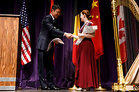 Mark Lu of the Shanghai Hantang Culture Development Co. Ltd. presents first prize winner Melanie Laurent from France with the Hantang Culture Trophy during the awards ceremony of the 11th USA International Harp Competition at Indiana University in Bloomington, Indiana on Saturday, July 13, 2019. (Photo by James Brosher)