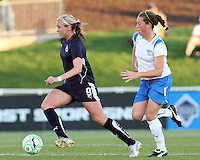 Allie Long #9 of the Washington Freedom breaks away from Kasey Moore #17 of the Boston Breakers during a WPS match at the Maryland Soccerplex, in Boyd's, Maryland, on April 18 2009. Breakers won the match 3-1.