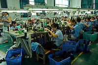 """Workers at the Shuangshuang Sock Company in """"Datang Sock Town"""" in Zhuji City Zhejiang Province, China. The town in Zhejiang Province makes more than 5.3 billion pairs of socks annually - that 2.5 pairs for every human alive..14 Jun 2006"""