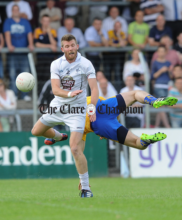 Ciaran Fitzpatrick of Kildare in action against Rory Donnelly of Clare during their All-Ireland qualifier game in Ennis. Photograph by John Kelly.