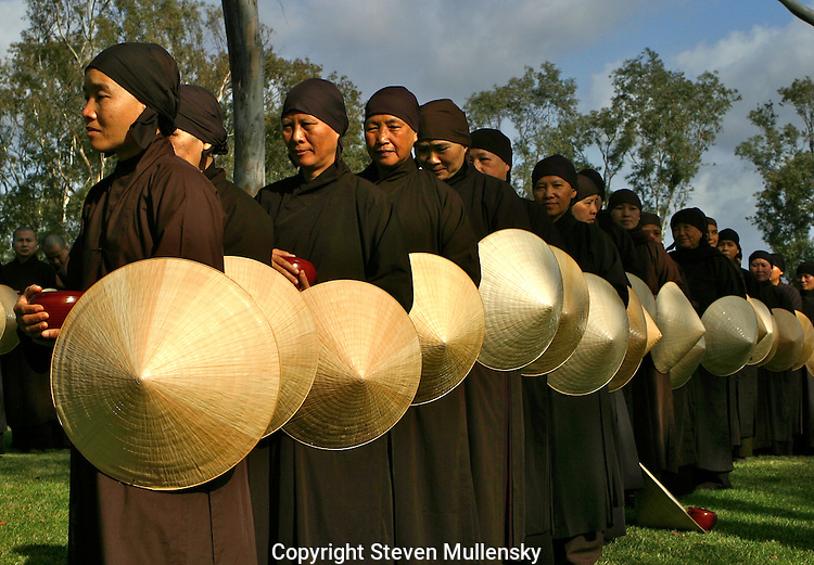Buddhist nuns line up and await the arrival of Zen Master Thich Nhat Hana to San Dieguito Park in Solana Beach, California.