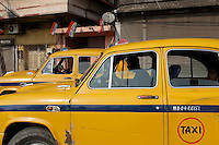 Kolkata's distinctive yellow taxis sit in a traffic jam in the center of the city.<br />