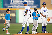 Malcom Culver #24 and Yowill Espinal #7 of the Burlington Royals prior to the National Anthem at Burlington Athletic Park July 19, 2009 in Burlington, North Carolina. (Photo by Brian Westerholt / Four Seam Images)