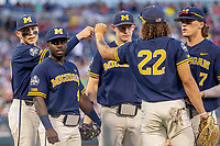 Michigan Wolverines second baseman Ako Thomas (4) in between innings against the Vanderbilt Commodores during Game 3 of the NCAA College World Series Finals on June 26, 2019 at TD Ameritrade Park in Omaha, Nebraska. Vanderbilt defeated Michigan 8-2 to win the National Championship. (Andrew Woolley/Four Seam Images)
