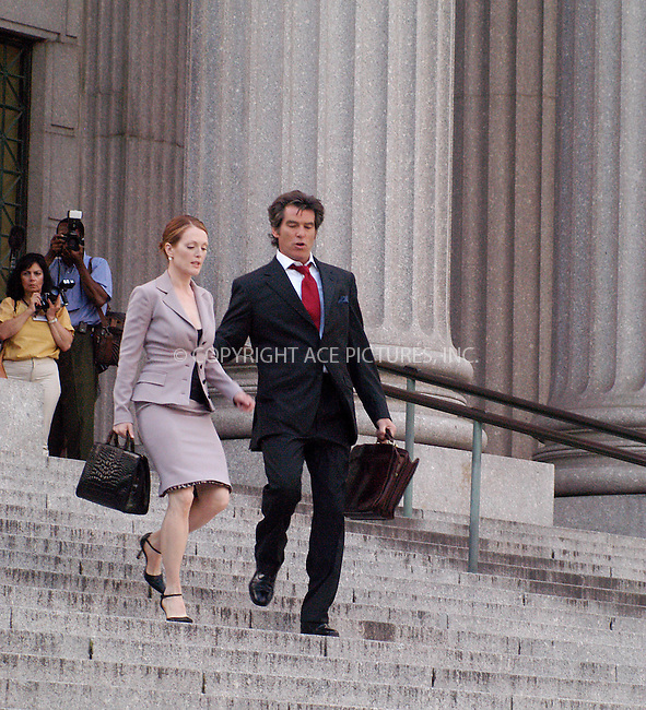 """Pierce Brosnan and Julianne Moore filming their new movie, """"The Laws of Attraction"""" on the steps of Manhattan's Courthouse. Pierce Brosnan plays a divorce lawyer who falls in love with and weds another divorce attorney (Julianne Moore). If any couple can avoid the pitfalls and problems plaguing so many marriages, it's this one, right? Wrong.....New York, August 14, 2003. Please byline: NY Photo Press.   ..*PAY-PER-USE*      ....NY Photo Press:  ..phone (646) 267-6913;   ..e-mail: info@nyphotopress.com"""