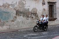 Antigua, Guatemala.  Couple on Motorbike, no Helmet.