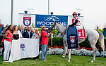 TORONTO, ON - SEPTEMBER 16: Connections gather in the winner's circle after World Approval #1 (red cap), ridden by John Velazquez, won the Ricoh Woodbine Mile on Ricoh Woodbine Mile Day at Woodbine Racetrack on September 16, 2017 in Toronto, Ontario. (Photo by Scott Serio/Eclipse Sportswire/Getty Images)
