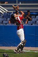 Batavia Muckdogs catcher Brad Haynal (23) catches a popup during a game against the State College Spikes August 23, 2015 at Dwyer Stadium in Batavia, New York.  State College defeated Batavia 8-2.  (Mike Janes/Four Seam Images)