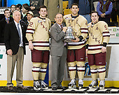 Jerry York (BC - Head Coach), Paul Carey (BC - 22), Tommy Cross (BC - 4) and Barry Almeida (BC - 9) pose with Steve Nazro and the Beanpot. - The Boston College Eagles defeated the Boston University Terriers 3-2 (OT) to win the 2012 Beanpot championship on Monday, February 13, 2012, at TD Garden in Boston, Massachusetts.