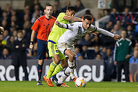 Dele Alli of Tottenham Hotspur holds off Andy Najar of R.S.C Anderlecht during the UEFA Europa League Group J match between Tottenham Hotspur and R.S.C. Anderlecht at White Hart Lane, London, England on 5 November 2015. Photo by Andy Rowland.