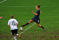 USA's Lauren Cheney shoots from close range against Germany.  The USA captured the 2010 Algarve Cup title by defeating Germany 3-2, at Estadio Algarve on March 3, 2010.