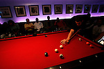Kevin Love plays pool at Jay Z's 40/40 Club while other players watch MTV's Video Music Awards on TV on August 31, 2006.  The high school players were in town for the Elite 24 Hoops Classic, which brought together the top 24 high school basketball players in the country regardless of class or sneaker affiliation.