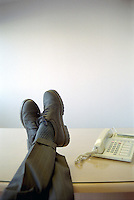 Businessman with feet on desk.
