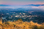 The Missoula, Montana valley and the downtown area with a layer of fog at the western edge of the valley